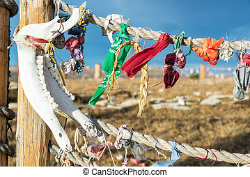 Jawbone and Colorful Cloth - Jawbone and colorful cloth at...