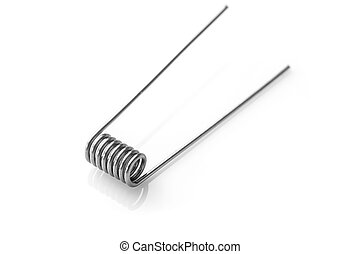 stainless coil for vaping on a white background macro...