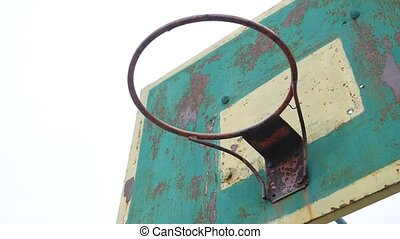 old basketball hoop sport outdoors rusty iron ball enters...