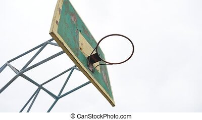 old basketball hoop outdoors rusty iron sport ball enters...