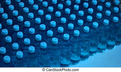 Lots of water bottles. Bottles with blue caps. Simple means...