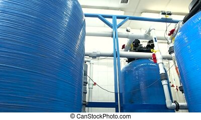 Industrial water filters. White pipes and red valves....