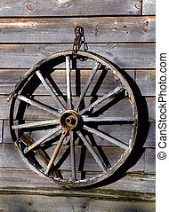Antique Wagon Wheel - Antique wagon wheel hangs on side of...