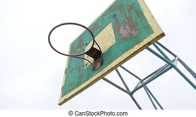 old basketball hoop bottom sport view outdoors rusty iron...