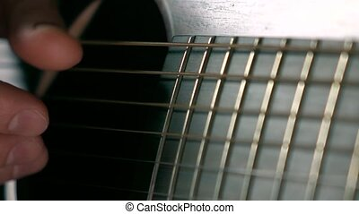 Guitarist touching guitar strings. Music performance. Super...