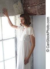 Beautiful Woman in a White Dress in Window Light - Photo of...