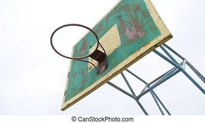 old basketball hoop bottom view sport outdoors rusty iron...