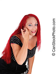 Woman with red hair bending down. - A closeup portrait of a...