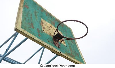 old basketball hoop outdoors rusty iron ball enters the...