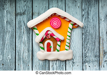 Christmas decorative house on the wooden background
