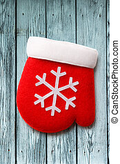 Red christmas mitten with white snowflake ornament