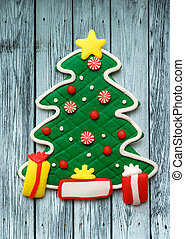 Christmas decorative tree on the wooden background