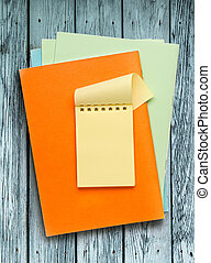 Notepads on the wooden background