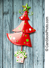 Christmas tree toy decoration on wooden background