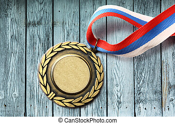 Metal medal with tricolor ribbon in closeup