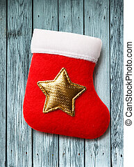 Red christmas stocking with golden star ornament
