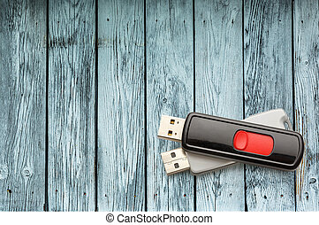 Usb flash drives on the wooden background