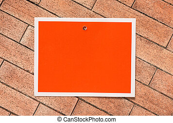 Blank red card on the brick background