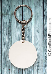 Key ring with round trinket on wooden background