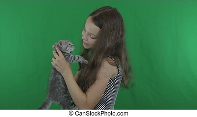 Beautiful girl communicates with kitten Scottish Fold on...