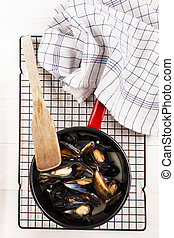 freshly cooked mussels in an enamel pot - freshly cooked...