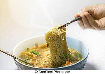Noodles the popula fart food - Fork over noodles in a hot...