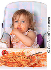 Messy baby girl eating spaghetti - Young blue eyed baby girl...
