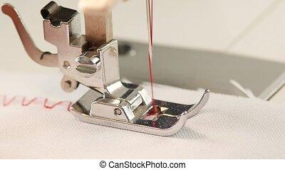 Machine zigzag stitch. Slow motion - Machine zigzag stitch,...