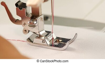 Needle is slowly sews. Slow motion - Needle is slowly sews,...