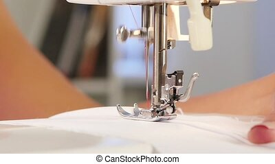 Needle pierces the fabric. Slow motion - Needle pierces the...