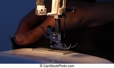 Sewing. Slow motion - Sewing, woman sews on the sewing...