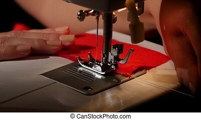 Sew on a sewing machine. Slow motion - Sew on a sewing...
