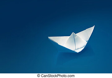 Paper ship - Small white paper ship over a blue background