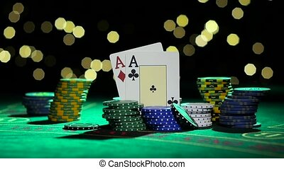 Combination of poker. Pair of aces. Rolling one green chip...