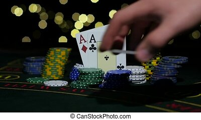 Poker Chips and Two Aces. Dealer takes all poker chips. Close up. Slow motion