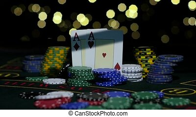 Poker Chips and Two Aces. Close up. Slow motion