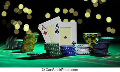 Combination of poker. Pair of aces. Falling poker chips on a...