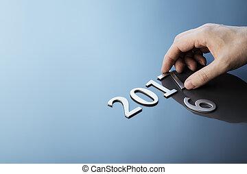 Ready for 2017 - Man making number 2017 using metallic...