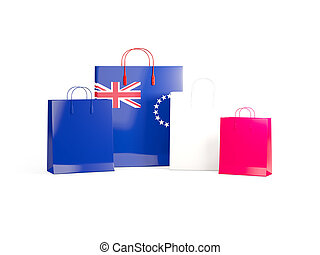 Flag of cook islands on shopping bags. 3D illustration