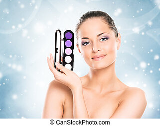 Portrait of a young woman in light makeup on light blue -...