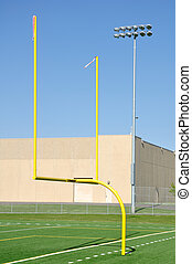 Goal Posts on American Football Field - Yellow Goal Posts on...