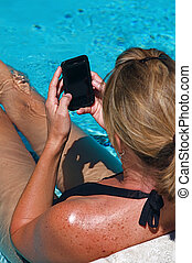 Swimming Pool - Beautiful woman working on her...
