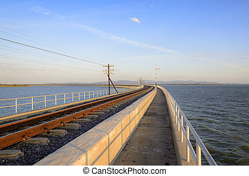 railway or railroad along the lake with the light of morning