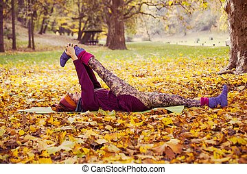 woman exercise in autumn park