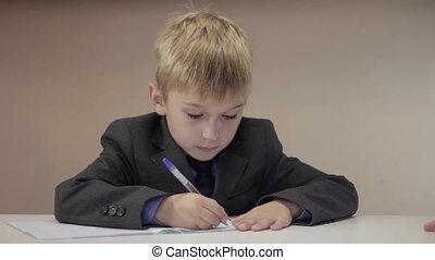 teacher help boy write