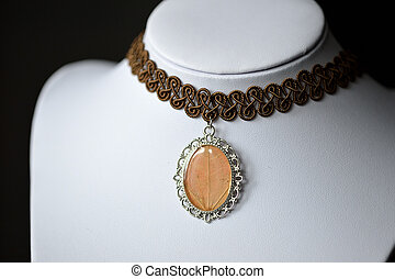Choker necklace with a pendant from epoxy resin and maple...