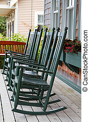 Four green rocking chairs - Four green wooden rocking chairs...