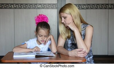 Girl and mother were distracted from reading and fun look...