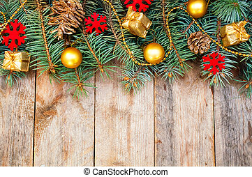 Christmas tree branches with cones, gifts and toys on a...
