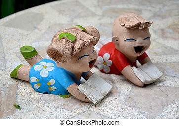 Clay dolls children boy and girl reading book